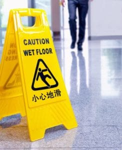 Sign to prevent slip and fall negligence cases